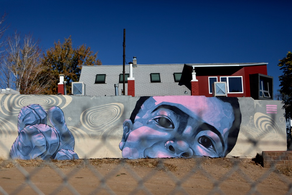 A mural in Highland, at West 33th Avenue and Osage Street. (Andrew Kenney/Denverite)