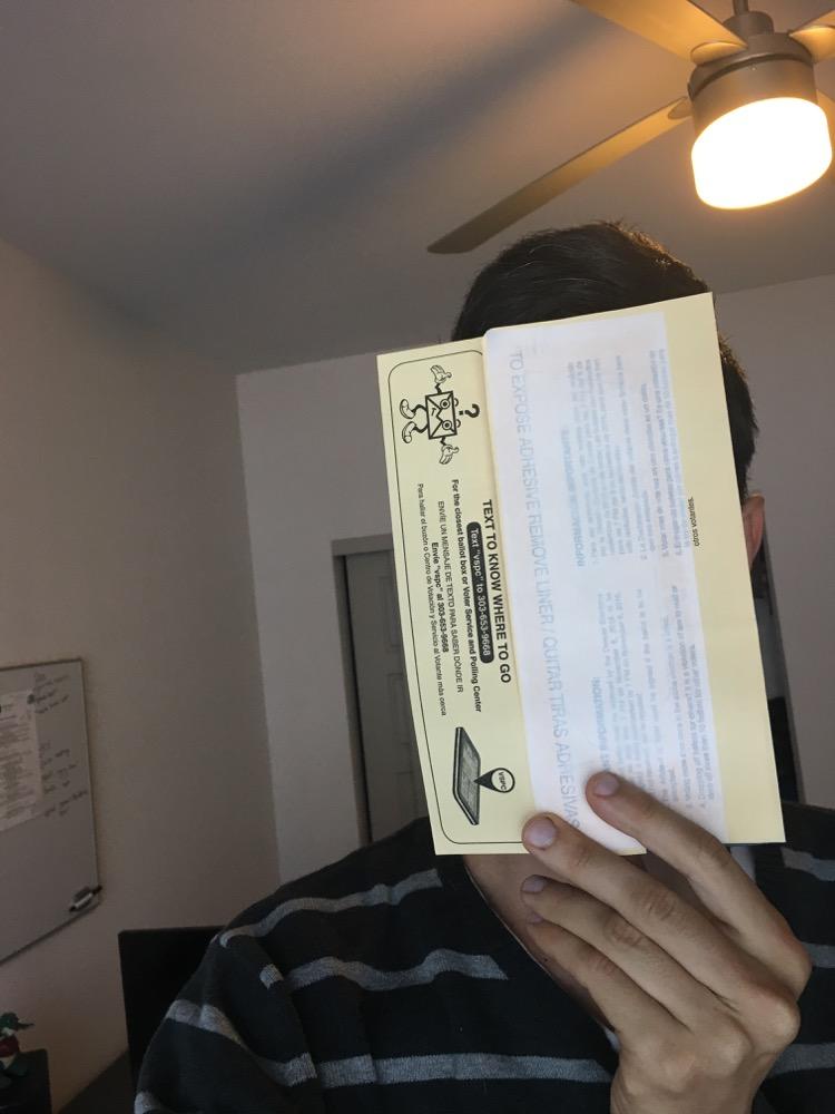 Ballot envelope selfie. (Andrew Kenney/Denverite)