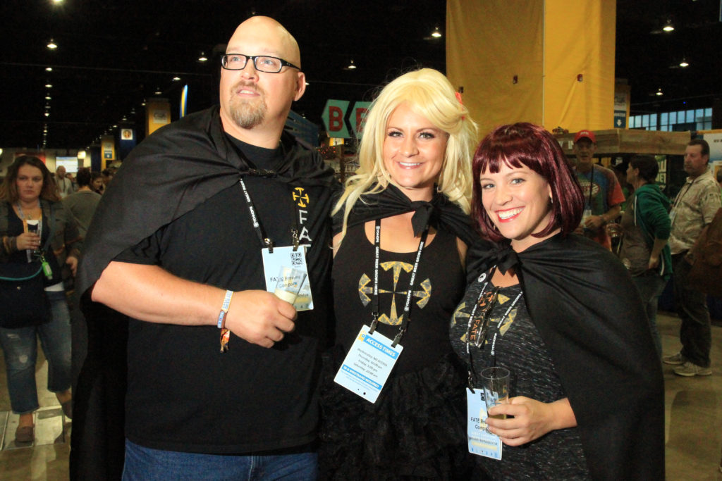 Paul Myers, Aylssa Lundgren and Kodi Kelly with Boulder's FATE Brewing Company at Great American Beer Festival, Oct. 7, 2016. (Stephanie Snyder/Denverite)
