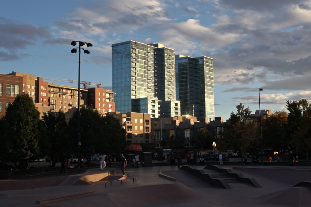 New apartments and condos loom over the Denver Skate Park. (Andrew Kenney/Denverite)