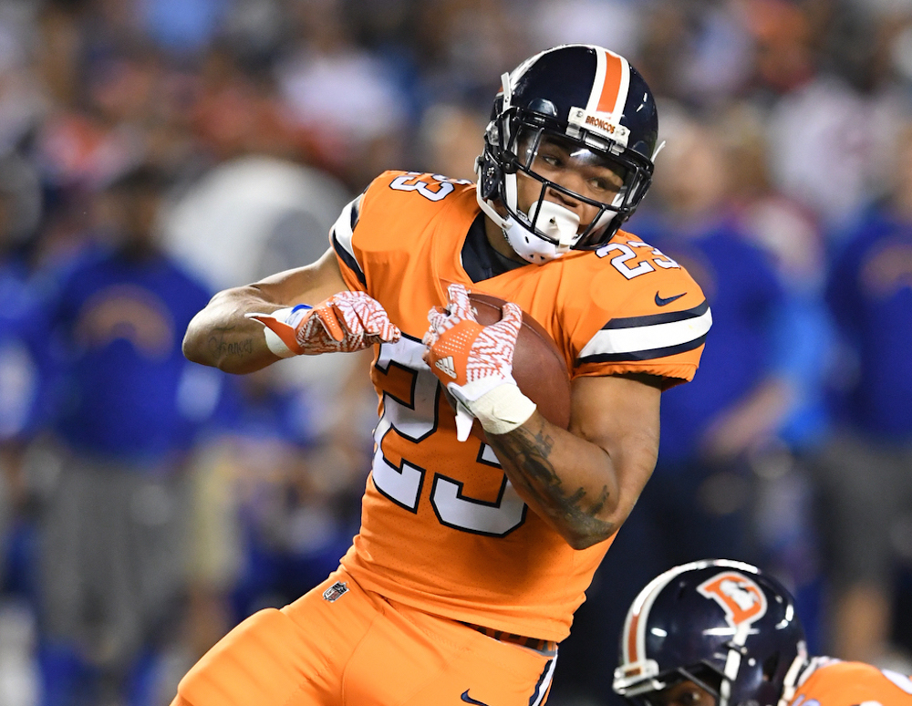 Denver Broncos Devontae Booker (23) rushes 5 yards during third quarter  action against the San Diego Chargers in the NFL game at  Qualcomm Stadium in San Diego, Ca  October 13, 2016. (Photo: © Eric Lars Bakke/Denver Broncos)