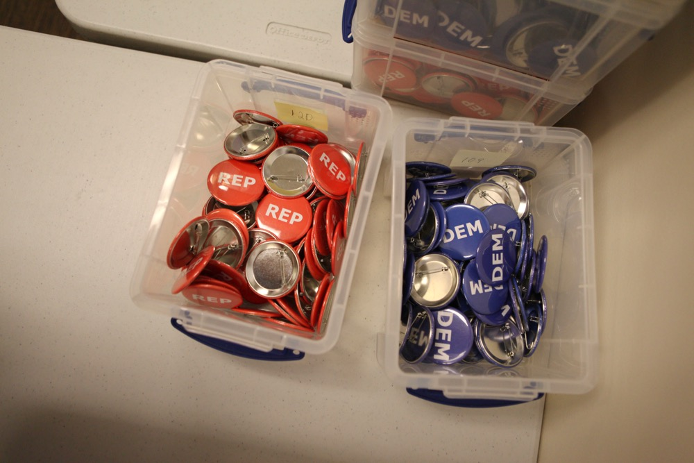 Buttons worn by bipartisan judges in Denver. (Andrew Kenney/Denverite)