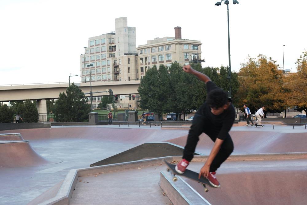 A skateboarder rides Denver Skate Park. (Andrew Kenney/Denverite)