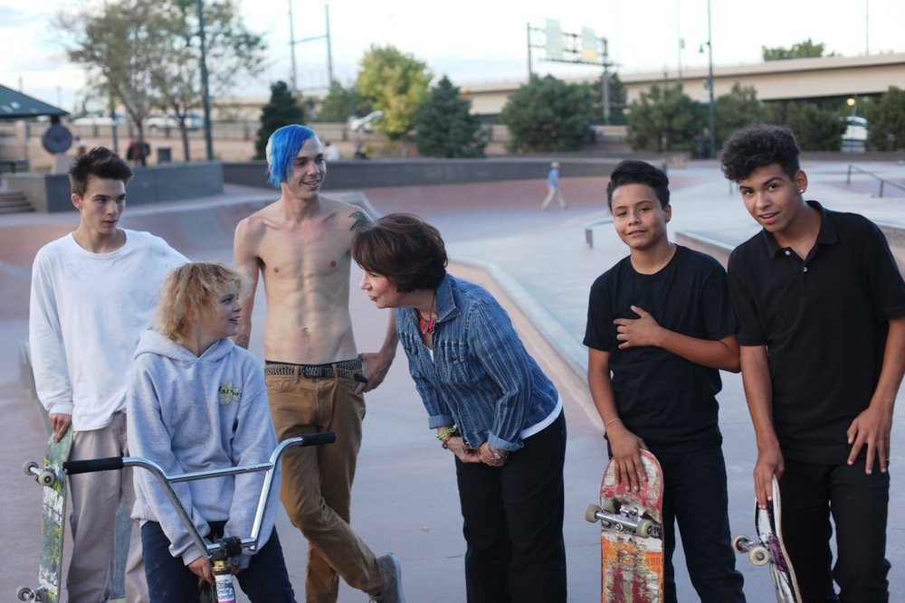 Former councilwoman Joyce Foster played a key role in creating the Denver Skate Park. Here, she meets her constituents. (Andrew Kenney/Denverite)