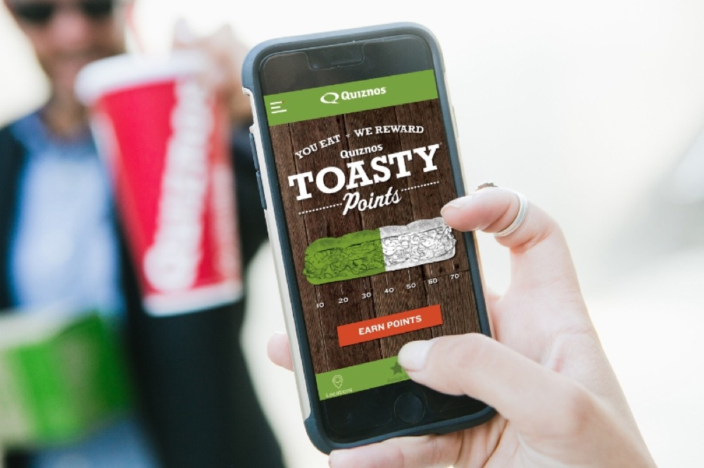 Toasty Points, allows guests to earn and redeem points for free Quiznos menu items at locations across the country. (PRNewsFoto/Quiznos)