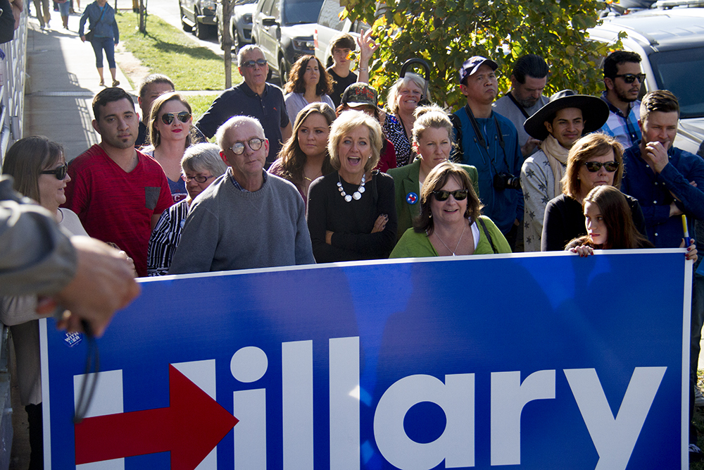 Hillary supporters eagerly await outside of EXDO to catch a glimpse of Bill Clinton as he exits. (Kevin J. Beaty/Denverite)  copolitics; denver; colorado; denverite; kevinjbeaty; politics; election; campaign;