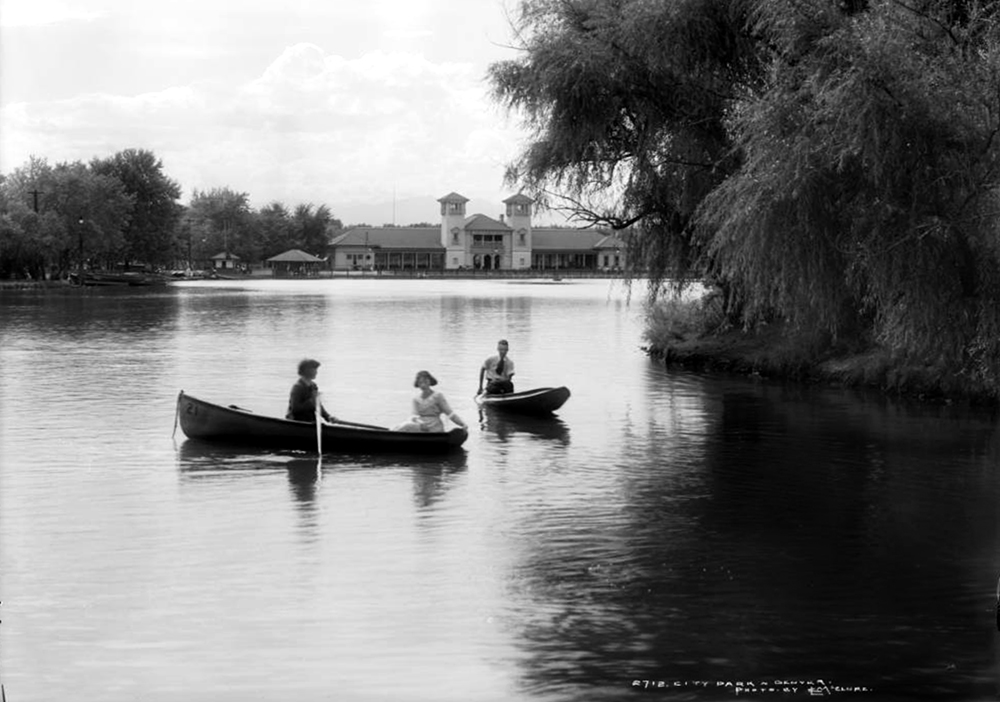View of children in rowboats on the lake in City Park, Denver, Colorado; shows pavilion and boathouse in background. Between 1918 and 1919. (Louis Charles McClure/Denver Public Library/Western History Collection/MCC-2712)  historic; denver public library; dpl; archive; archival; denverite