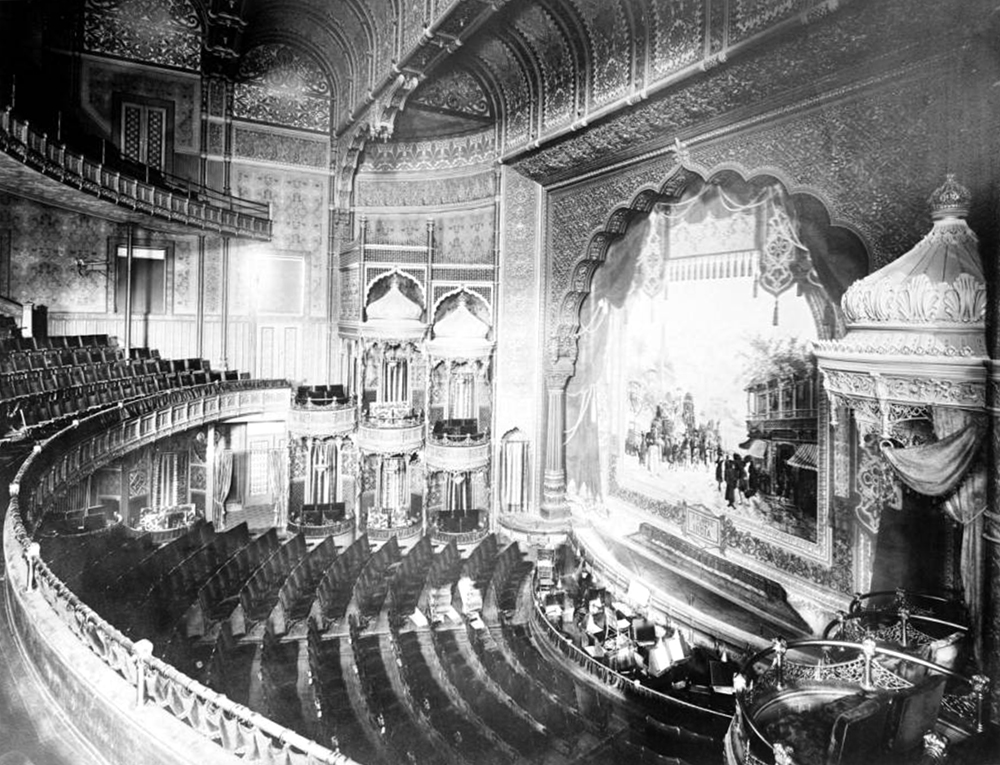 "Interior view of Broadway Theatre located in Metropole Hotel on Broadway, Denver, Colorado; shows balcony, private box seats, orchestra pit, stage, and scenery curtain from ""A glimpse of India;"" theater opened in 1890. Circa 1900. (Louis Charles McClure/Denver Public Library/Western History Collection/MCC-6)  historic; denver public library; dpl; archive; archival; denverite"