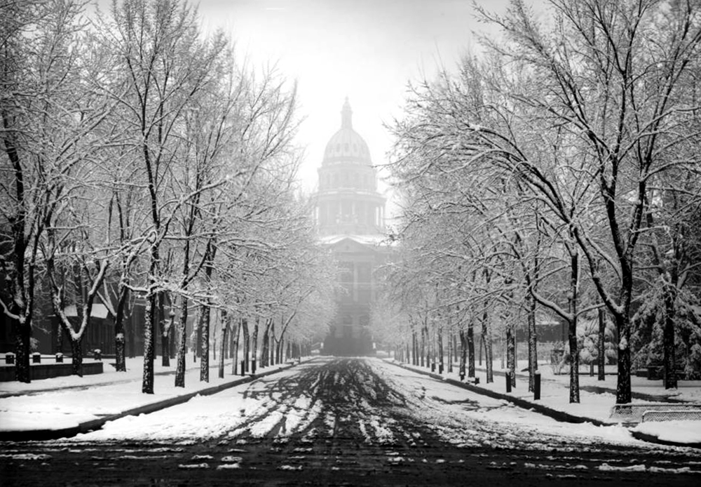 View south on Sherman Avenue towards Colorado State Capitol building during spring snowstorm in April, Denver, Colorado. 1913. (Louis Charles McClure/Denver Public Library/Western History Collection/MCC-1906)  historic; denver public library; dpl; archive; archival; denverite; capitol building; gold dome;