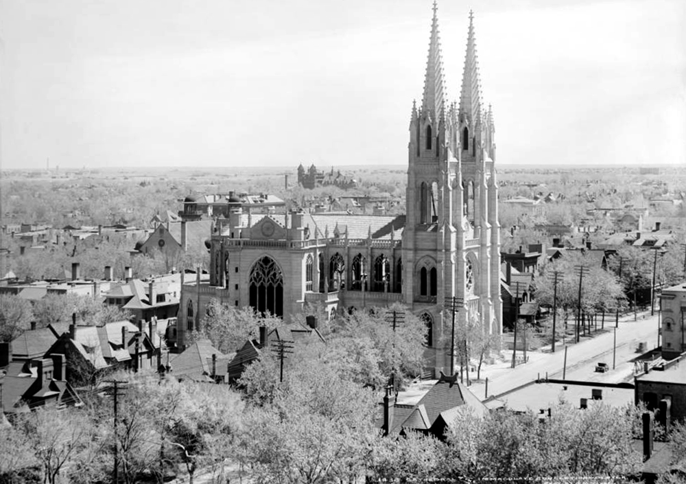 View of Immaculate Conception Cathedral (Colfax Avenue and Logan Street) under construction, Denver, Colorado (also called Basilica of the Immaculate Conception). Formal dedication of Cathedral was on October 27, 1912. Scene also includes Saint Joseph's Hospital, Temple Emanuel, residences surrounding the cathedral, Denver Museum of Natural History, and Clayton College (East 32nd Avenue and Colorado) in the distant center left. 1912. (Louis Charles McClure/Denver Public Library/Western History Collection/MCC-1432)  historic; denver public library; dpl; archive; archival; denverite