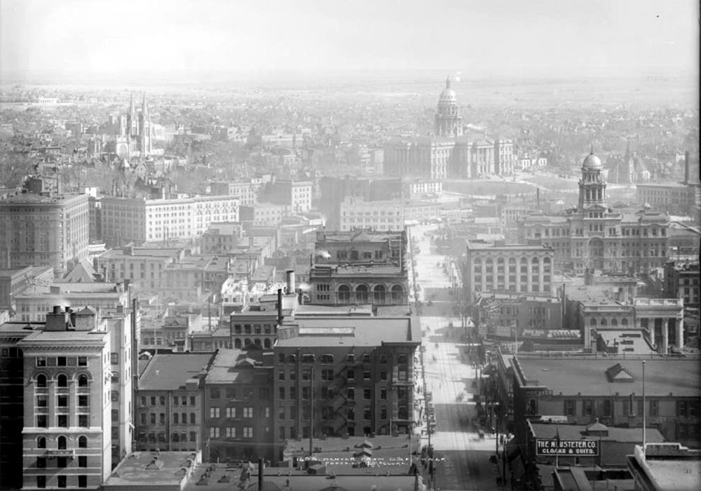 Bird's eye view of Denver, Colorado from Daniels & Fisher Tower, 16th & Arapahoe southeast down 16th towards Colorado State Capitol building & grounds, Colorado State Museum (Colorado State Historical Sociey) at East 14th Avenue & Sherman Street under construction, Arapahoe County Court house, Immaculate Conception Cathedral, edge of Brown Palace, Y.M.C.A. 1912. (Louis Charles McClure/Denver Public Library/Western History Collection/MCC-1655)  historic; denver public library; dpl; archive; archival; denverite