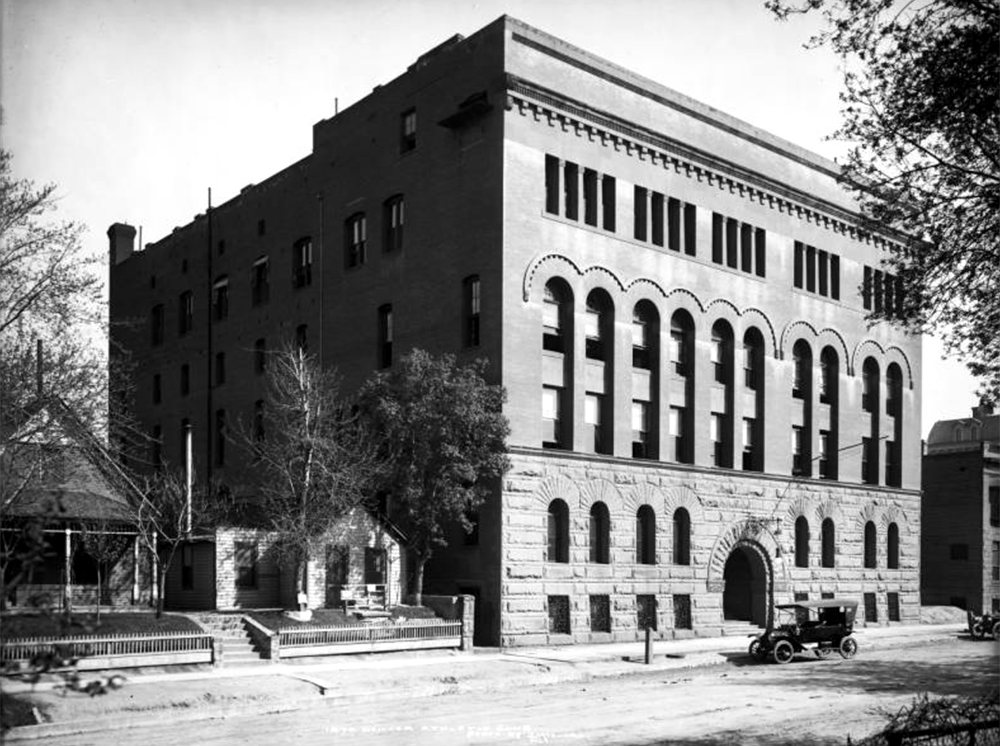 Exterior view of Denver Athletic Club including section added in 1892, 1325 Glenarm Place, Denver, Colorado; originally built in 1890, second part added to right of door. Between 1900 and 1920. (Louis Charles McClure/Denver Public Library/Western History Collection/MCC-1870)  historic; denver public library; dpl; archive; archival; denverite