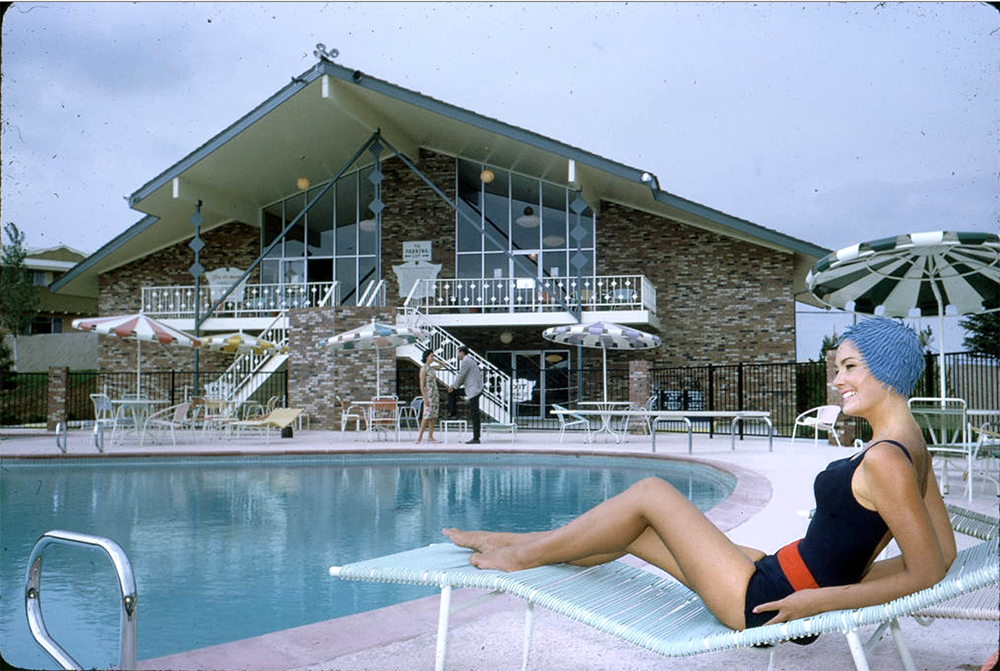 View of the clubhouse and swimming pool at the Green Mountain Townhouses in Lakewood, Colorado. Circa 1965. (Lloyd Rule/Denver Public Library/Western History Collection/Z-11829)  history colorado; historic; denver public library; dpl; archive; archival; denverite