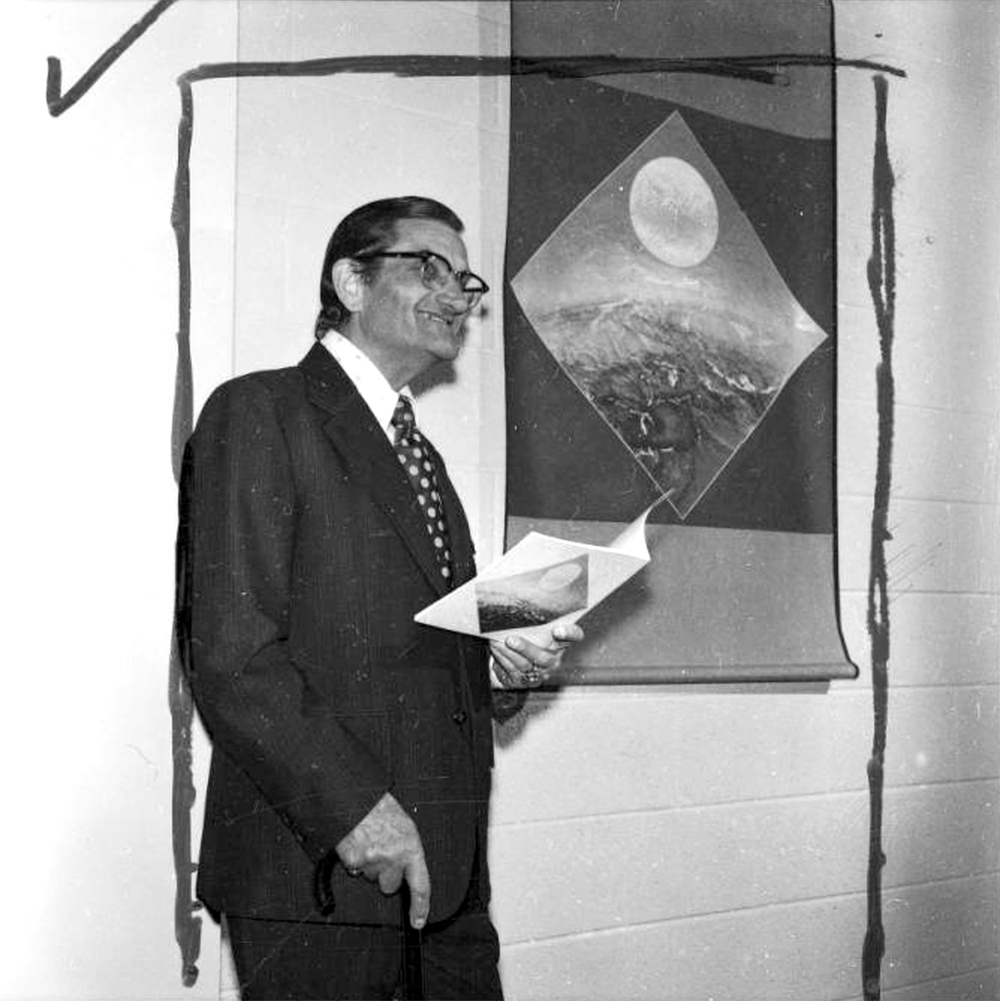 Vance Kirkland, a well known artist, administrator and teacher, poses beside one of his paintings at the Denver Art Museum, Denver, Colorado. 1973. (Lloyd Rule/Denver Public Library/Western History Collection/Z-11856)  history colorado; historic; denver public library; dpl; archive; archival; denverite
