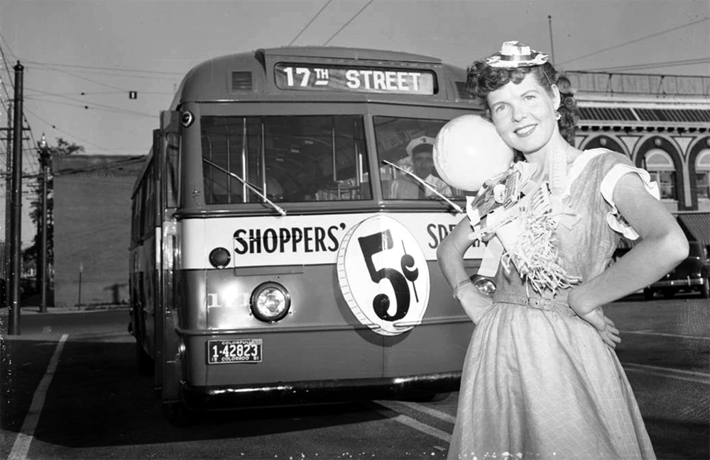 A model poses by a Denver Tramway streetcar in Denver, Colorado. 1951. (Lloyd Rule/Denver Public Library/Western History Collection/Z-10142)  history colorado; historic; denver public library; dpl; archive; archival; denverite