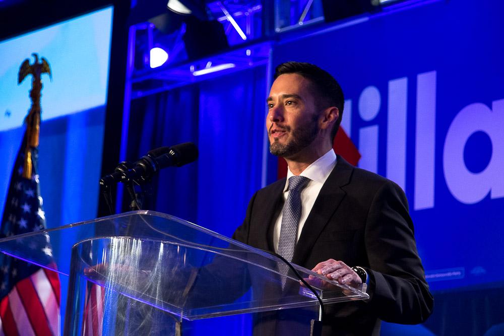 Rick Palacio speaks at the Democratic watch party. (Chloe Aiello/Denverite)