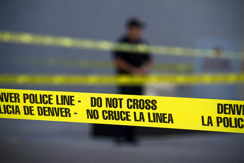 Police tape. (Kevin J. Beaty/Denverite)