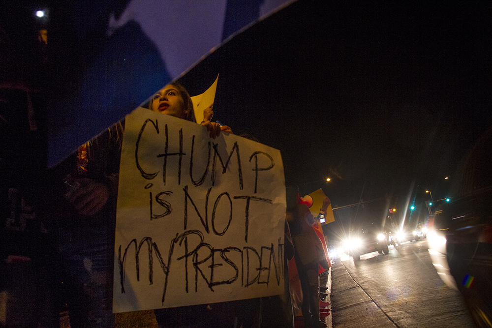Protesters hold signs on Federal at 5th during a rally against Donald Trump. Nov. 9, 2016. (Kevin J. Beaty/Denverite)  rally; protest; trump; politics; copolitics; election; valverde; kevinjbeaty; denver; denverite; colorado;