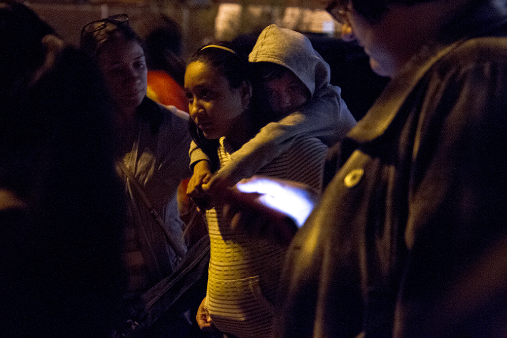 Jacqueline Reyes and Anjel, her little brother, look on during an anti-Trump rally held by Latino students at Federal and 5th on Nov. 9, 2016. (Kevin J. Beaty/Denverite)  rally; protest; trump; politics; copolitics; election; valverde; kevinjbeaty; denver; denverite; colorado;