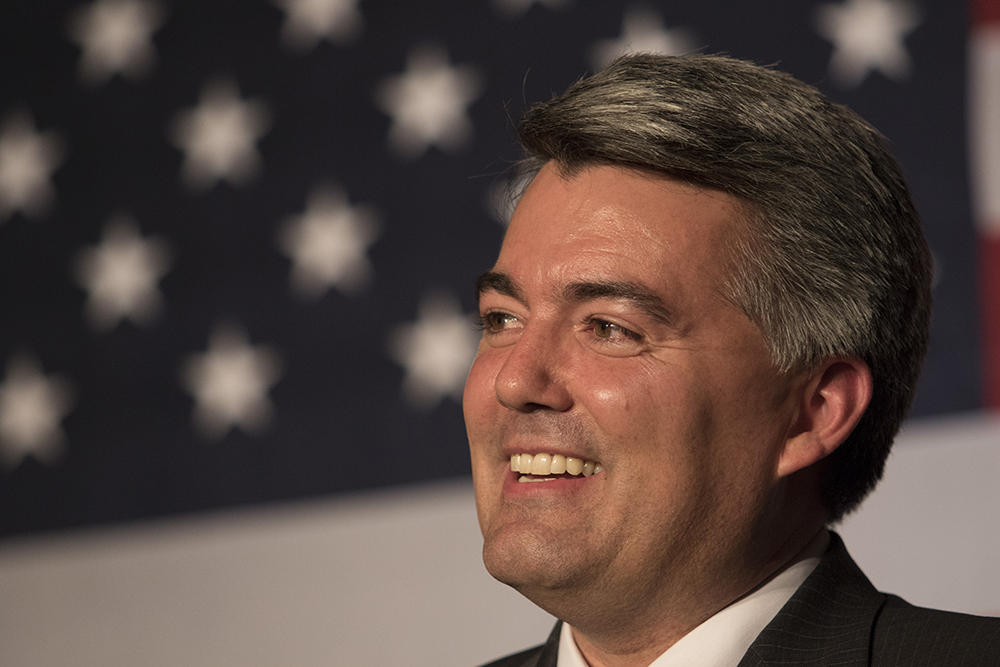 Senator Cory Gardner  watch as U.S. Rep. Mike Coffman greets the crowd as the victor at the 2016 GOP watch party at the Double Tree Hotel in Greenwood Village on Nov. 8, 2016.  (Jessica Taves/For Denverite)  election; republican; campaign; vote; voting; politics; colorado; copolitics; kevinjbeaty; denverite; denver; colorado; corygardner;