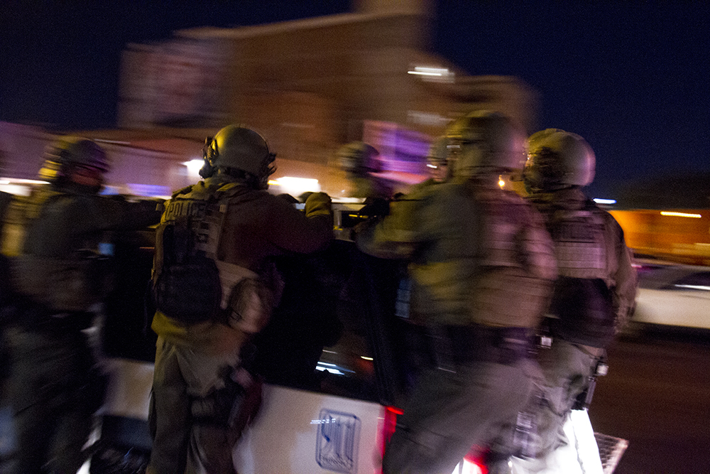 Denver's Metro Swat Bureau officers take off on 12th Ave south of the Denver Art Museum as protester factions split up after the initial march. An anti-Trump rally. Nov. 11, 2016. (Kevin J. Beaty/Denverite)  politics; protest; denver; denverite; kevinjbeaty; colorado; trump;