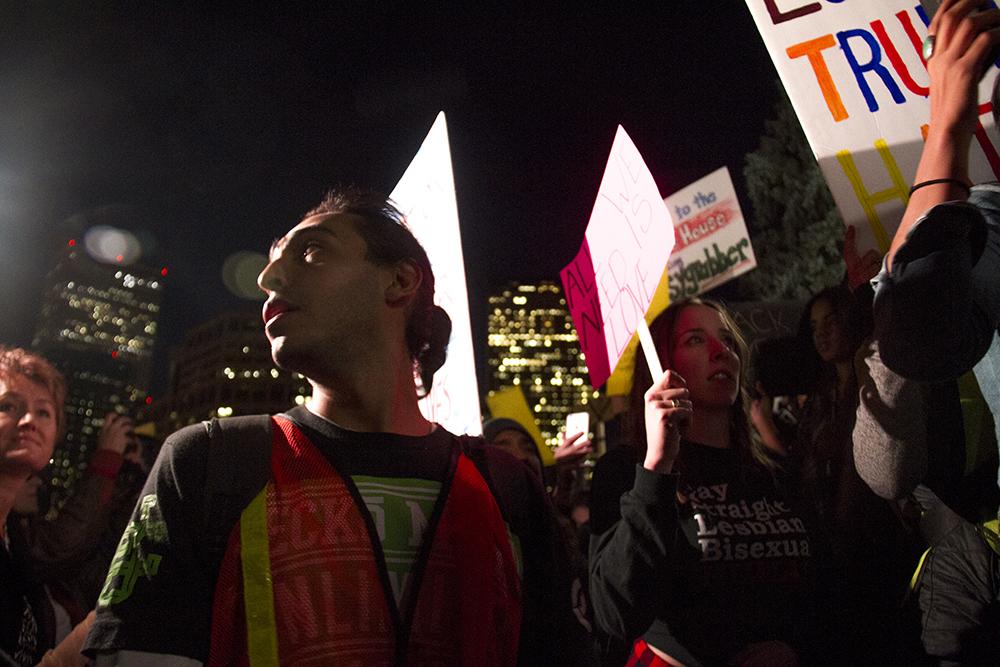 Jazs Orion stands amid a massive crowd at the Capitol. An anti-Trump rally. Nov. 11, 2016. (Kevin J. Beaty/Denverite)  politics; protest; denver; denverite; kevinjbeaty; colorado; trump;