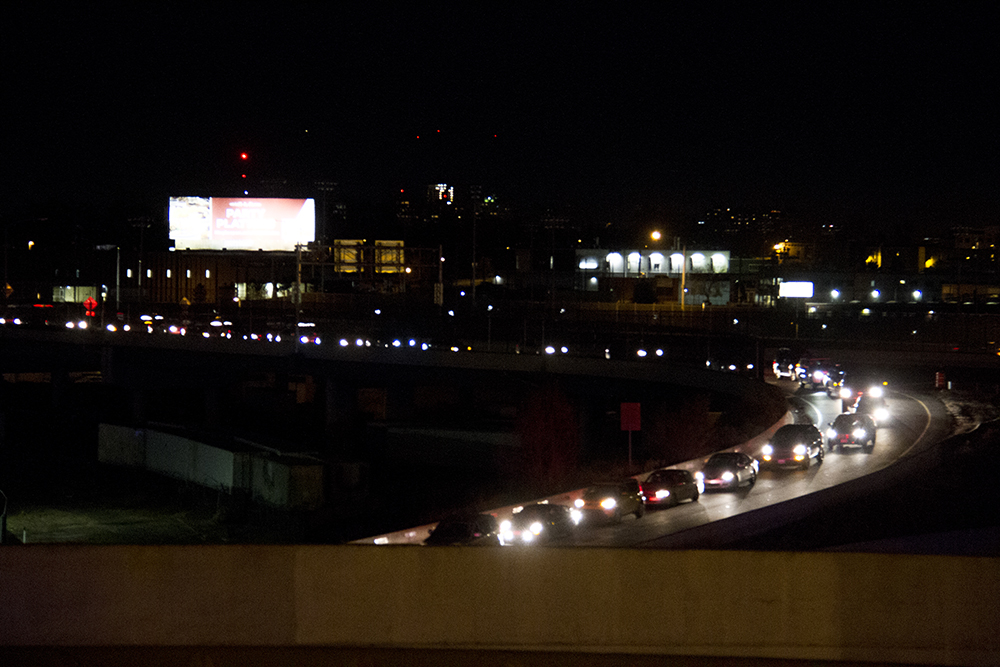 Cars are stuck at near standstill on an I-25 onreamp as protesters attempt to block the highway. An anti-Trump rally. Nov. 11, 2016. (Kevin J. Beaty/Denverite)  politics; protest; denver; denverite; kevinjbeaty; colorado; trump;