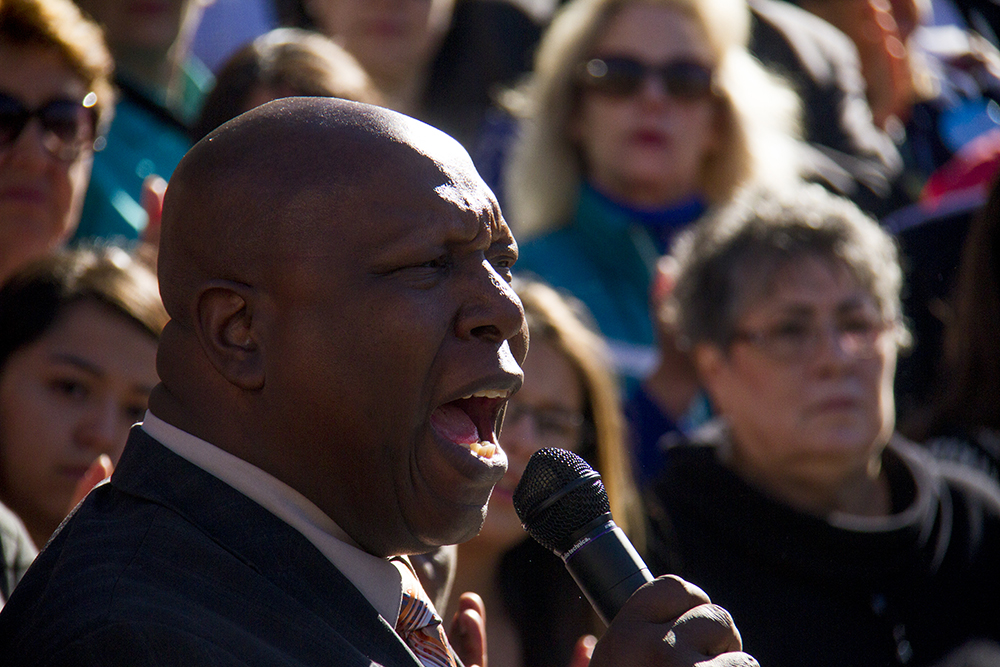 New Covenant Alpha and Omega's Pastor Terrence Hughes speaks at a rally against Donald Trump in reaction to his election just days prior. Nov. 10, 2016. (Kevin J. Beaty/Denverite)  rally; protest; trump; politics; copolitics; capitol; denver; denverite; colorado; kevinjbeaty; election;