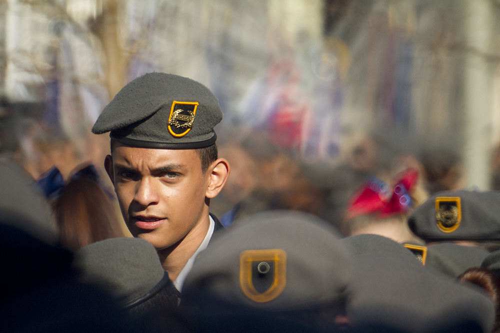 Lincoln High School freshman Hector Valenzuela waits for the start of the Veterans Day parade at Civic Center Park. Nov. 12, 2016. (Kevin J. Beaty/Denverite)  veterans day; jrotc; military; civic center park; denver; denverite; colorado; kevinjbeaty;