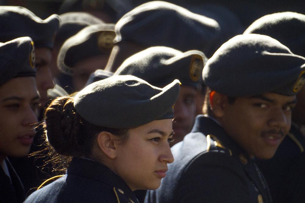 Lincolng High School senior Marina Ortiz waits for the Veterans Day parade at Civic Center Park to begin. Nov. 12, 2016. (Kevin J. Beaty/Denverite)  veterans day; jrotc; military; civic center park; denver; denverite; colorado; kevinjbeaty;