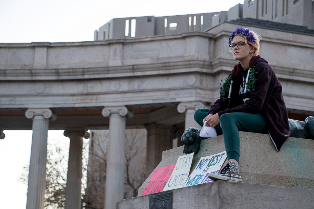 Sylas Fox, 15, overlooks Civic Center Park to support Community for Unity after Thursday's march. (Chloe Aiello/Denverite)