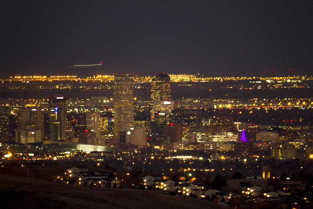Denver (with DIA in the background) as seen from Red Rocks. Nov. 14, 2016. (Kevin J. Beaty/Denverite)  denver; colorado; skyline; cityscape; sunset; evening; cowx; weather; kevinjbeaty; denverite;