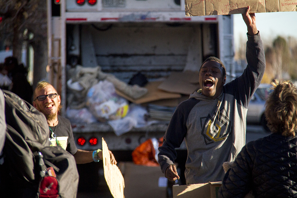 """King Reality (right) screams before """"homeless sweeps"""" begin on Nov. 15, 2016. (Kevin J. Beaty/Denverite)  homeless; sweeps; denver rescue mission; police; justice; kevinjbeaty; denver; denverite; colorado; camping ban; right to rest;"""