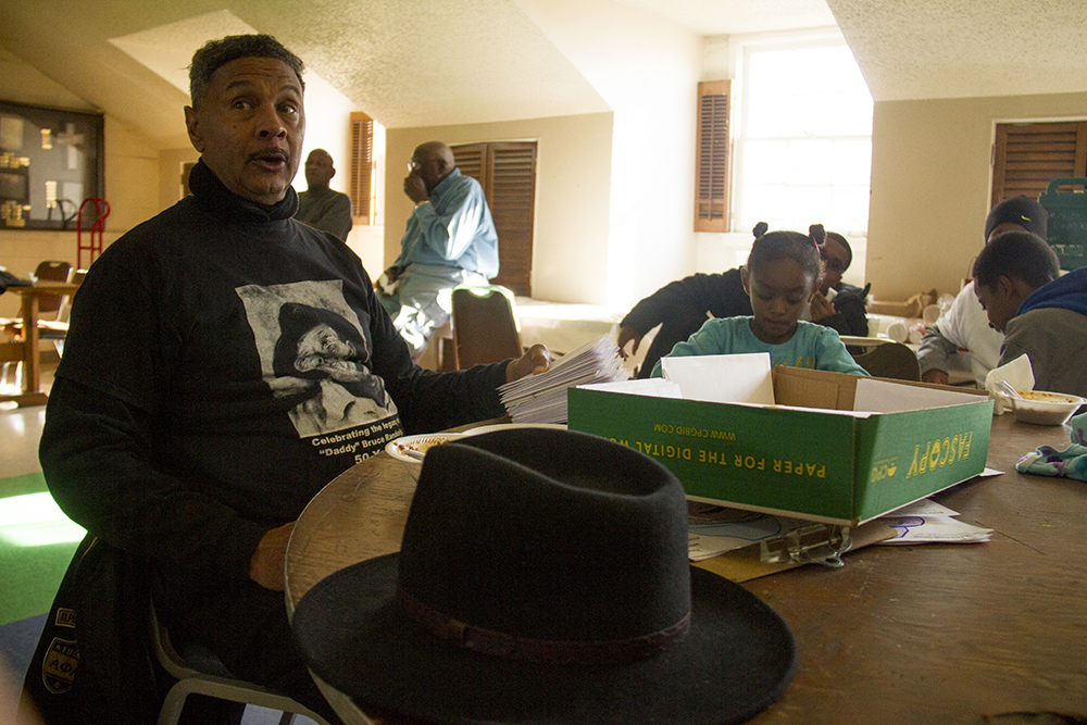 """Ronald Wooding talks about the documentary he produced on """"Daddy"""" Bruce Randolph that premiered this week after 14 years of work. The Epworth Foundation gives out Thanksgiving meal boxes. Nov. 11, 2016. (Kevin J. Beaty/Denverite)  High Street United Methodist Church; five points; bruce randolph; thanksgiving; volunteer; charity; community service; kevinjbeaty; denver; denverite; colorado"""