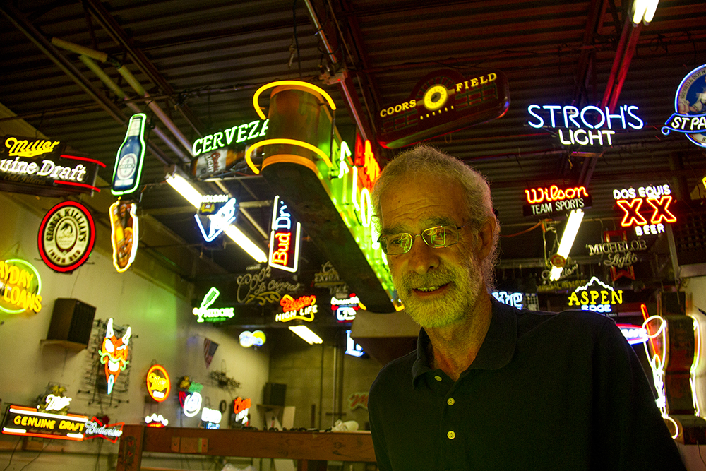 Glen Weseloh, son of the Morry's Neon namesake and second-generation master neon bender, poses for a photo. (Kevin J. Beaty/Denverite)  neon; denver; colorado; kevinjbeaty; denverite