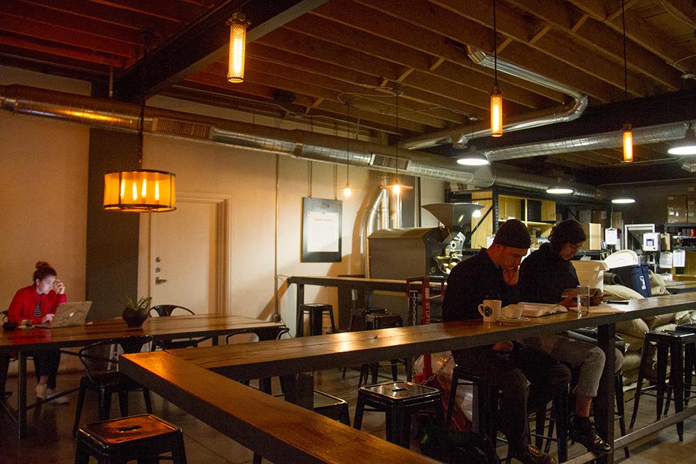 Aubreigh Brunschwig (left to right), Winn DeBurlo and Jasmine Vojdani work at Corvus Coffee, Platt Park. (Kevin J. Beaty/Denverite)  platt park; coffee shop; food; cozy; kevinjbeaty; denver; denverite; colorado;