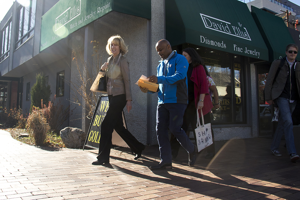 Mayor MIchael Hancock shops Cherry Creek on Small Business Saturday. Nov. 26, 2016. (Kevin J. Beaty/Denverite)  small business saturday; denver; denverite; retail; kevinjbeaty; colorado;