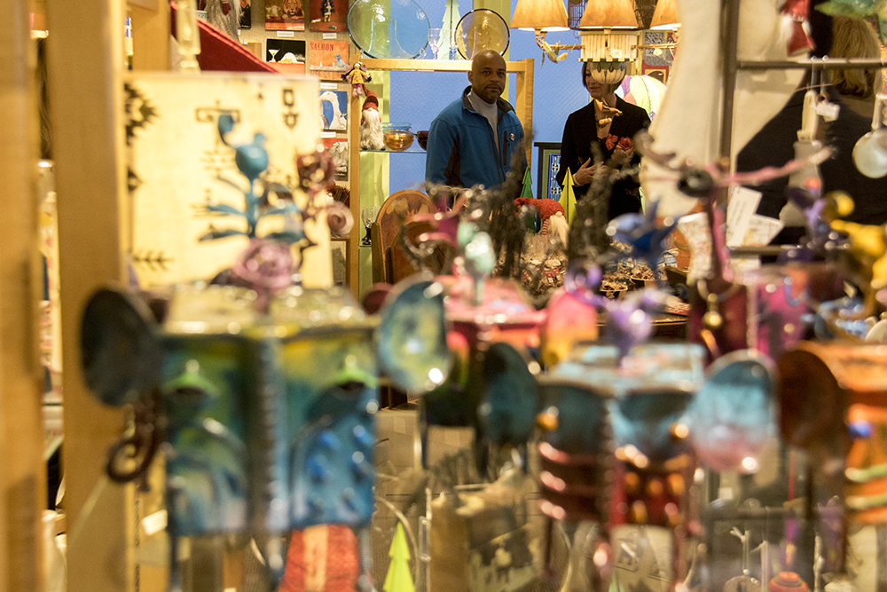 Mayor Michael Hancock visits Show of Hands on Small Business Saturday. Nov. 26, 2016. (Kevin J. Beaty/Denverite)  small business saturday; denver; denverite; retail; kevinjbeaty; colorado;