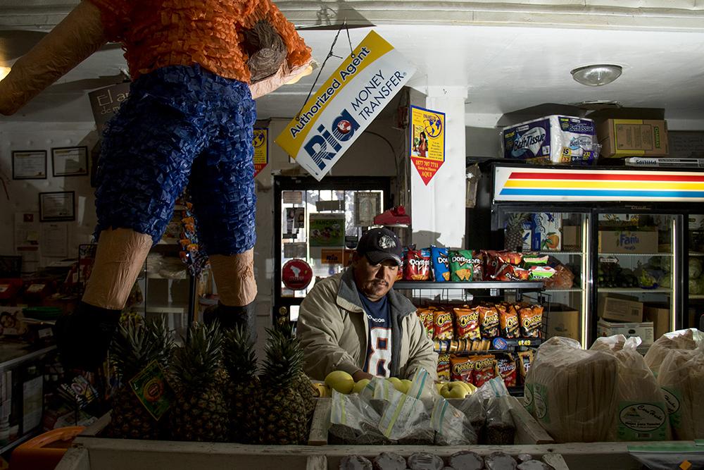 Juan Garcia in his bodega. Small Business Saturday. Nov. 26, 2016. (Kevin J. Beaty/Denverite)  small business saturday; denver; denverite; retail; kevinjbeaty; colorado;