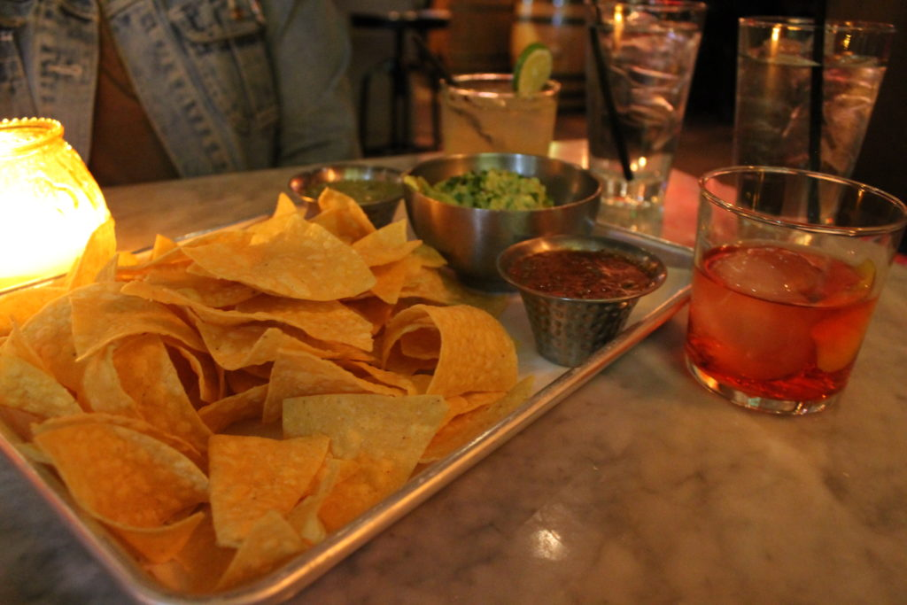 Chips, salsa and guacamole with a Paloma and a Buena Vida at La Güera, 1610 Little Raven St., #200. (Ashley Dean/Denverite)