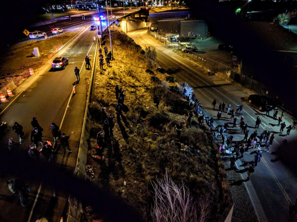 Anti-Trump protesters block I-25 as they march through central Denver Thursday night. (Kevin J. Beaty/Denverite)