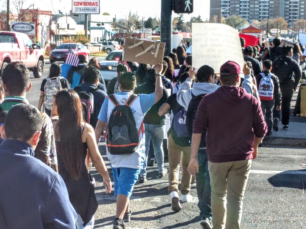 Student protesters on Federal Boulevard on Nov. 11, 2016. (Kevin J. Beaty/Denverite)