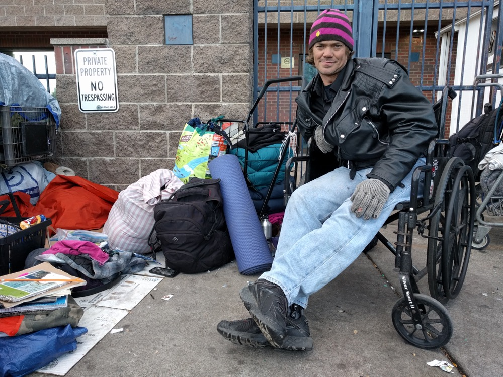 """JR Gerhard of Scranton. """"Nothing here is handicapped accessible. The east shelter is, but I have to climb a flight of stairs on the bus and take all my stuff with me. It's just easier to stay out here."""" (Kevin J. Beaty/Denverite)"""