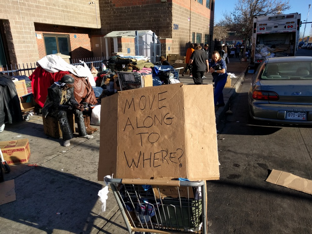 """Move Along To Where?"" a sign asks ahead of expected sweeps of homeless people on Nov. 15, 2016. (Kevin J. Beaty/Denverite) camping ban; right to rest; homeless;"