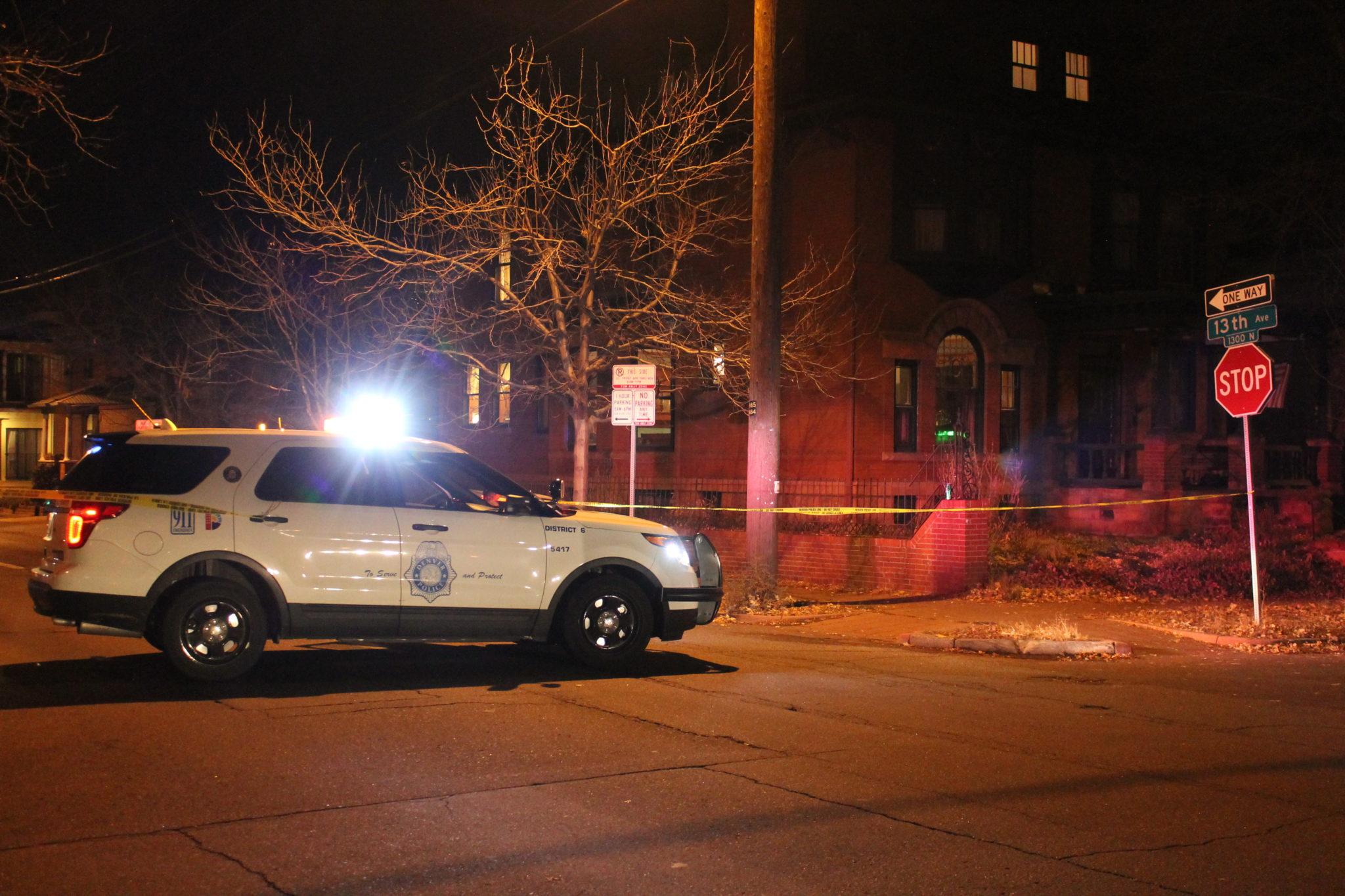Denver police blocked off the area around a homicide investigation at 13th Avenue and Marion Street. Nov. 22, 2016. (Ashley Dean/Denverite)
