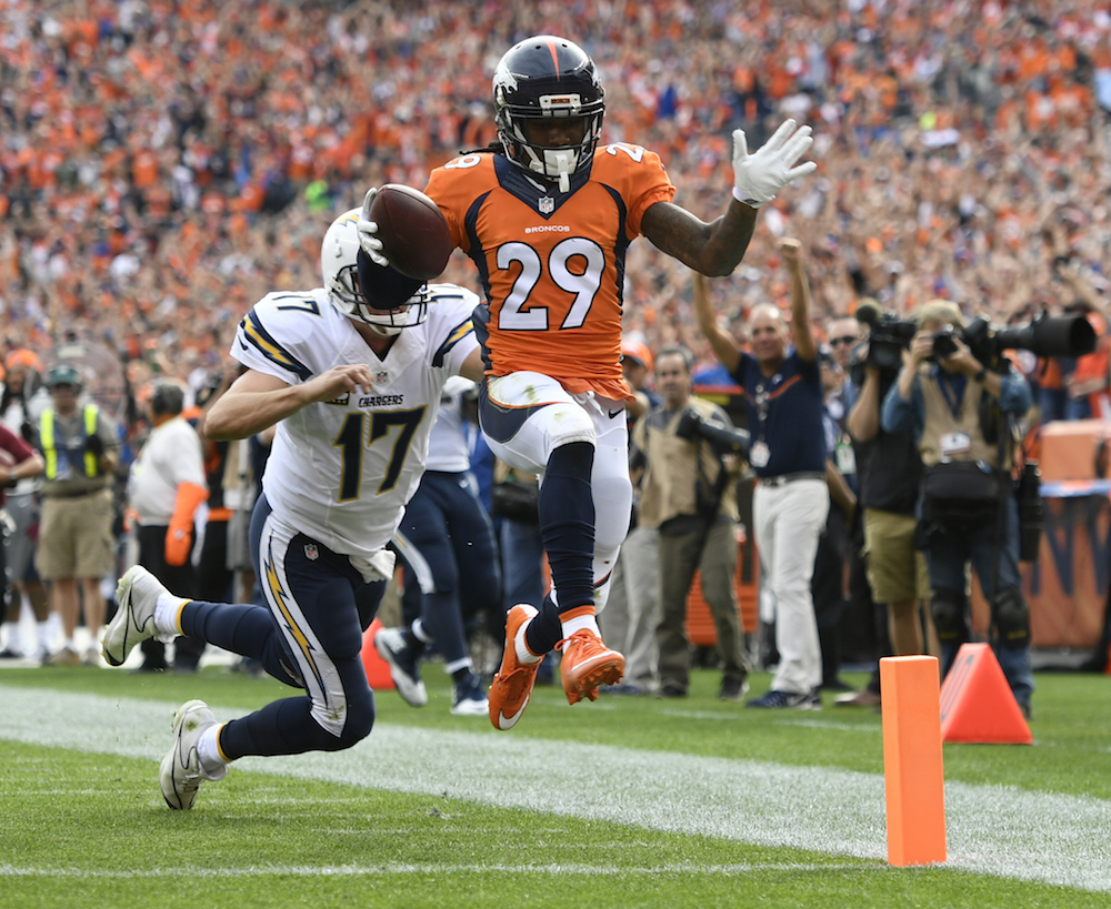 Denver Broncos cornerback Bradley Roby (29) scores on  a 49-yard interception during second quarter action against the San Diego Chargers in the NFL game at  Sports Authority Field in Denver, Colo. October 30, 2016. (Photo: © Eric Lars Bakke/ Denver Broncos)
