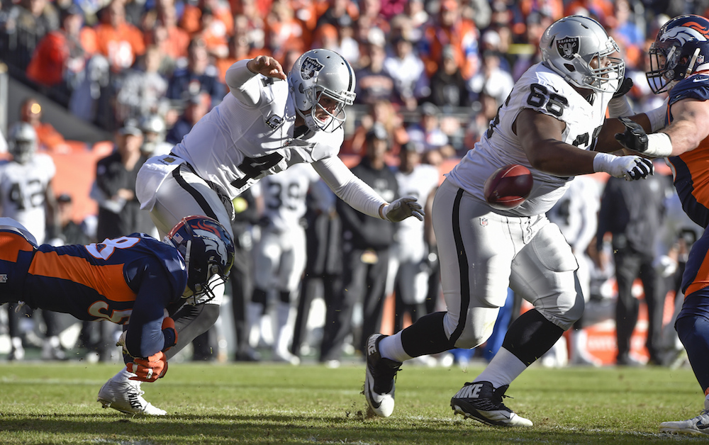 Denver Broncos linebacker Von Miller (58) sacks Oakland Raiders quarterback Derek Carr (4) forcing a fumble during first quarter action in the NFL game at Denver, Colo. December 13, 2015. (© Eric Lars Bakke/ Denver Broncos)