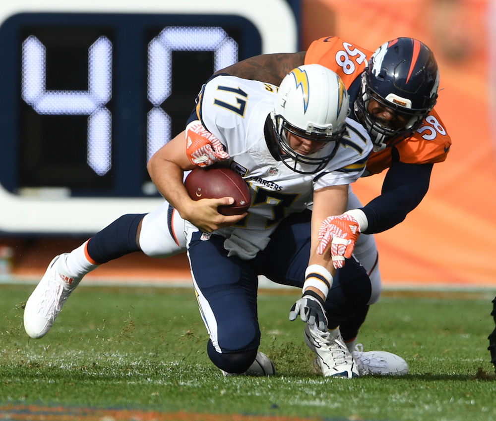 Denver Broncos linebacker Von Miller (58) sacks San Diego Chargers quarterback Philip Rivers (17) during first half  actionin the NFL game  Sports Authority Field in Denver, Colo. October 30, 2016.Photo: © Eric Lars Bakke/ Denver Broncos)