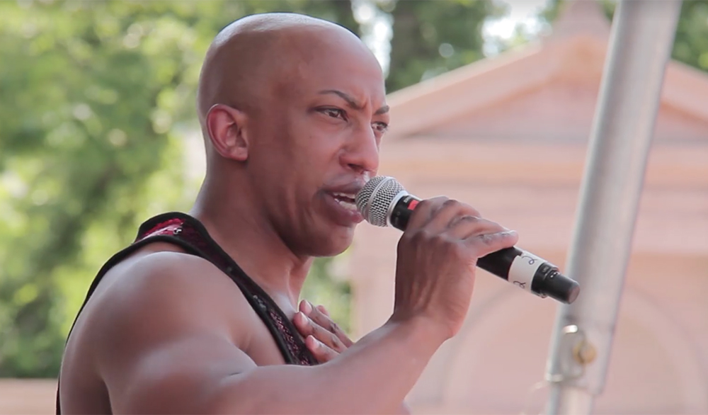 DeMarcio Slaughter speaks to Denver Pridefest. (Kevin J. Beaty/Denverite)