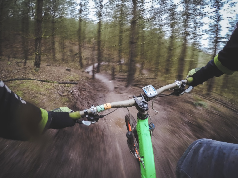 A first-person view of a mountain-bike ride. (Pexels)
